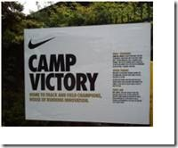 A large sign with the Nike Swoosh logo and the words