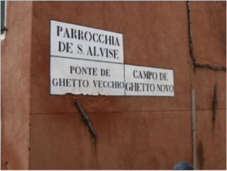 A red wall with three signs. They read Parrochia de s. alvise; ponte de ghetto vecchio; campo de ghetto novo